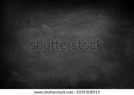 chalk rubbed out on blackboard...
