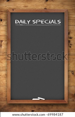 chalkboard menu with daily specials title on wooden background