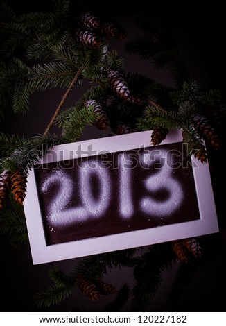 "Chalkboard on the pine with title ""2013"""