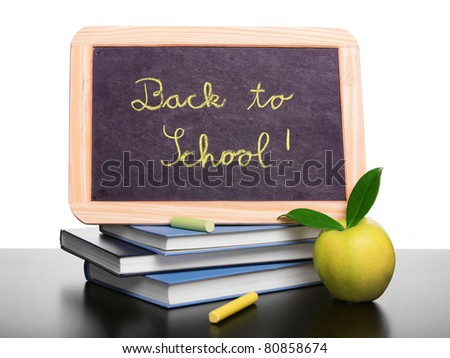 Chalkboard on the top of books, back to school concept