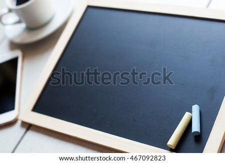 Chalkboard or Blackboard ready for text. Education or working concept. Stylish office background with coffee and mobile phone. #467092823