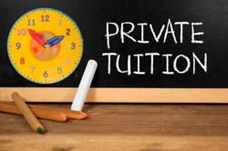 Chalkboard with chalk and pencils with private tuition