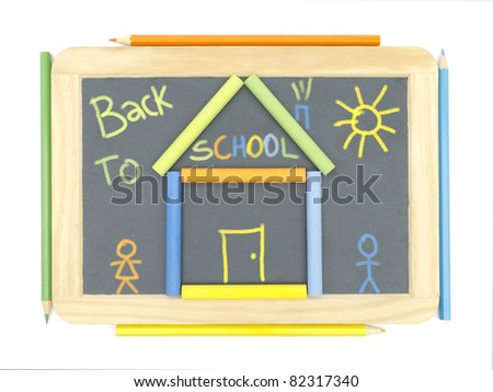 Chalkboard with drawing chalks and pencils