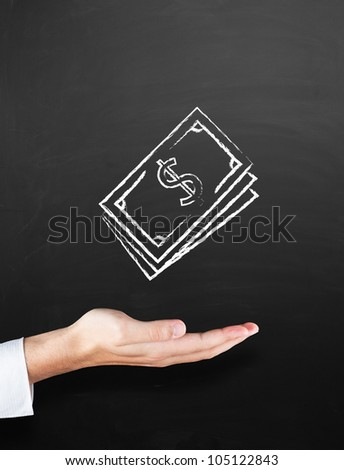 Chalkboard with hand and drawing concept of money