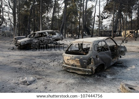 CHALKIDIKI, GREECE - AUGUST, 21 : Car ruins after fire disaster on August 21, 2006 in Chalkidiki peninsula, northern Greece