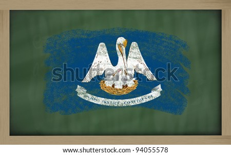 Chalky american state of louisiana flag painted with color chalk on old blackboard