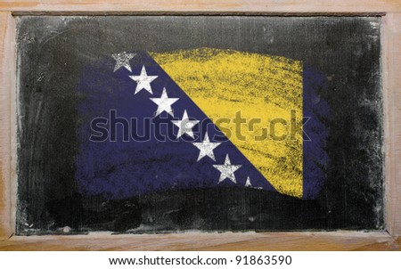 Chalky bosnia and herzegovina flag painted with color chalk on old blackboard