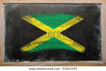 Chalky jamaican flag painted with color chalk on old blackboard