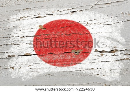 Chalky japanese  flag painted with color chalk on grunge wooden texture