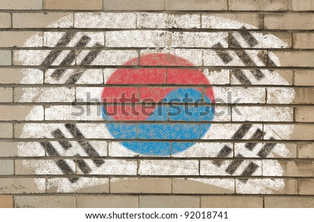 Chalky south korean flag painted with color chalk on grunge old brick wall