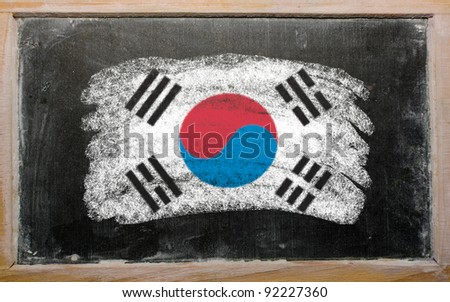 Chalky South Korean flag painted with color chalk on old blackboard