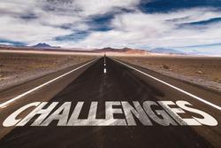 Challenges written on desert road