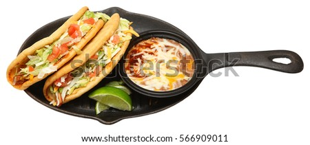 Chalupa and Pinto Beans on Cast Iron Skillet Over White #566909011