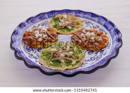chalupas poblanas, mexican food Puebla Mexico on a white background #1310482745