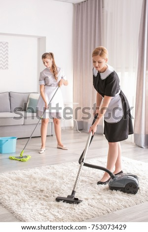 Chambermaids cleaning floor in room Сток-фото ©