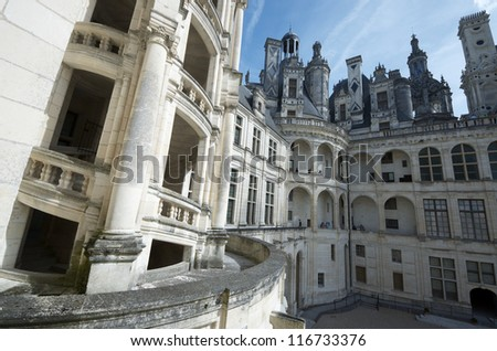 CHAMBORD, FRANCE - AUGUST 16: Castle on August 16, 2012 in Chambord: Tourists walk in Chambord Castle. Built as a hunting lodge for King Francois I, between 1519 and 1539.