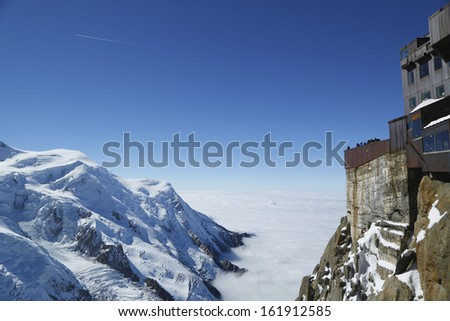 Chamonix terrace overlooking Mont Blanc massif at the mountain top station of the Aiguille du Midi (3842 m) in French Alps