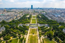 Champ de Mars view from top of eiffel tower looking down see the entire city as a beautiful classic architecture. A romantic place for lovers and family to visit.