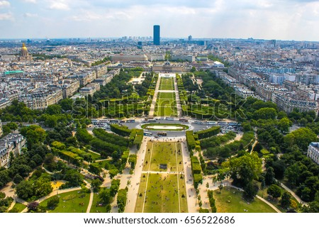 Champ de Mars view from top of eiffel tower looking down see the entire city as a beautiful classic architecture. A romantic place for lovers and family to visit.  Stock photo ©
