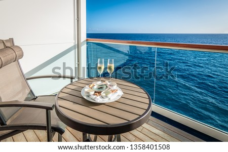 Champagne and caviar on balcony of cruise ship.