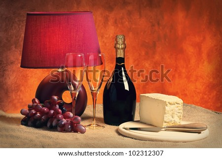 Champagne and wine glasses and cheese on the table