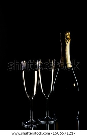 Champagne bottle and champagne glasses in low key #1506571217