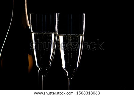 Champagne bottle and champagne glasses in low key #1508318063