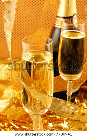 Champagne bottle and glasses  on gold background