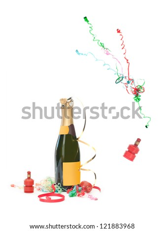 Champagne bottle and party streamer popping