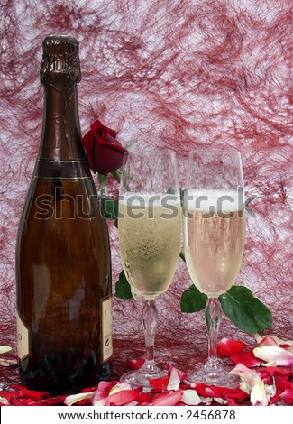 champagne bottle and two cups for celebrate san valentine`s day