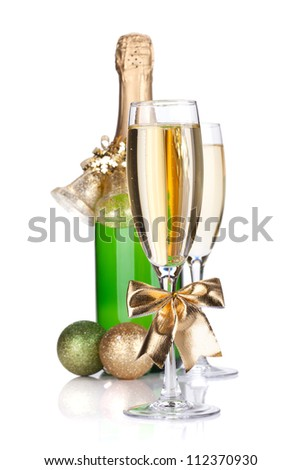 Champagne bottle, glasses and christmas decor. Small DOF. Isolated on white background