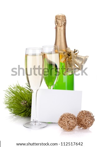 Champagne bottle, glasses and empty card. Isolated on white background