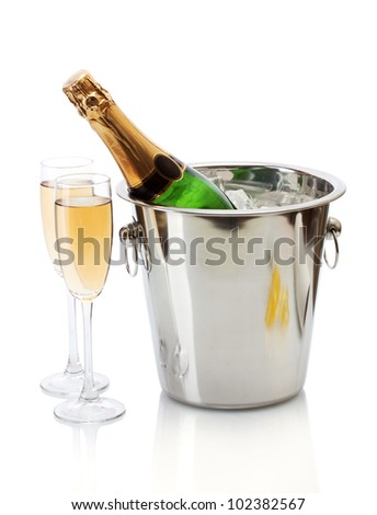 Champagne bottle in bucket with ice and glasses of champagne, isolated on white