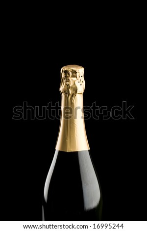 Champagne bottle isolated on a black background