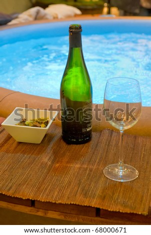Champagne bottle on the edge of a whirlpool