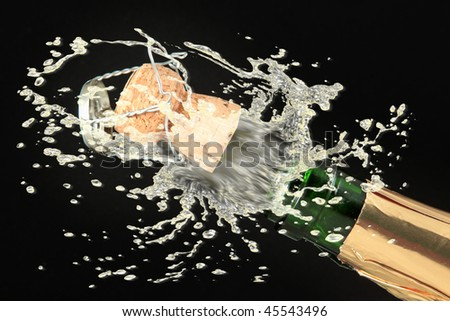 Champagne bottle ready for celebration - stock photo