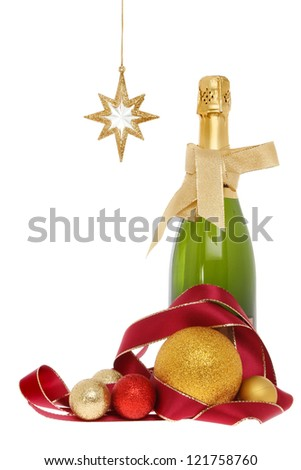 Champagne bottle with Christmas decorations of baubles ribbon and gold star isolated against white