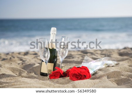 Champagne bottle with glasses and roses