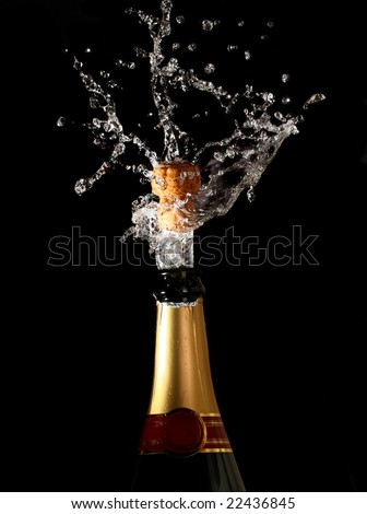 champagne bottle with shooting cork background