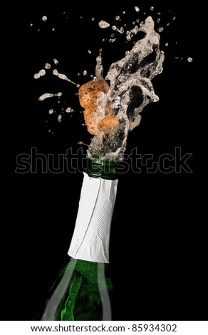 Champagne bottle with shooting cork, on black background