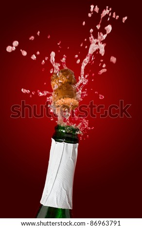 Champagne bottle with shooting cork, on red background