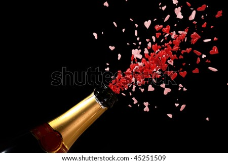 champagne bottle with shooting love red hearts black background