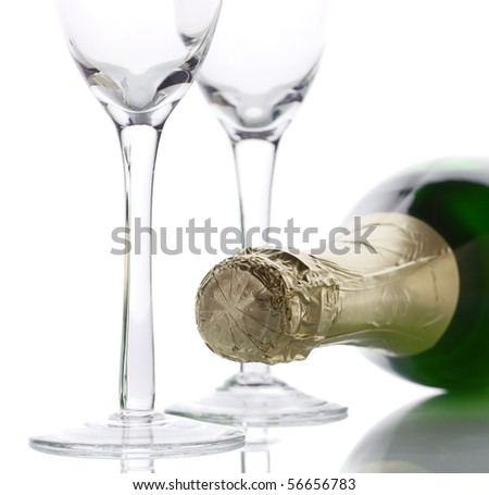Champagne bottle with two empty glasses (high key lighting)