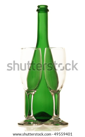 Champagne bottles and glasses on white background - stock photo