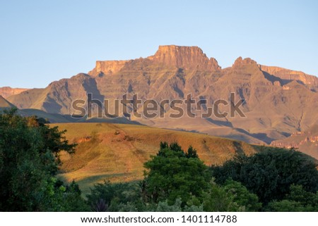 Champagne Castle, Cathkin Peak and Monk's Cowl: peaks forming part of the central Drakensberg mountain range, South Africa. Photographed at sunrise when the mountains turn the colour of champagne.