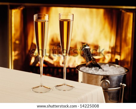 Champagne chilling by the fire