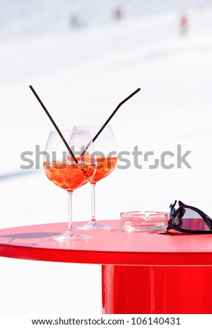 Champagne cocktails on a red table at Italian ski resort
