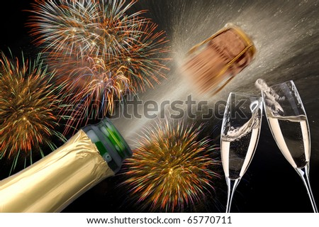 Champagne cork and glass with background firework at new year