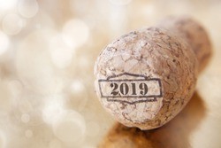 champagne cork closeup with 2019 on shining background