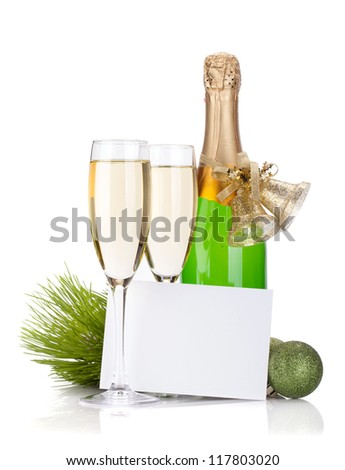 Champagne, empty card and christmas decor. Isolated on white background